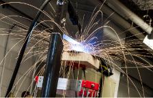 Michigan Tech's open-source 3-D metal printer in action imagecredits Chenlong Zhang